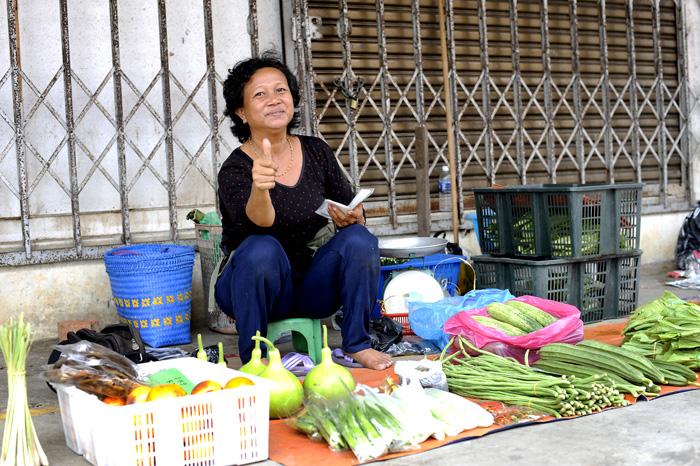 Dame i Marudi som selger grønnsaker.